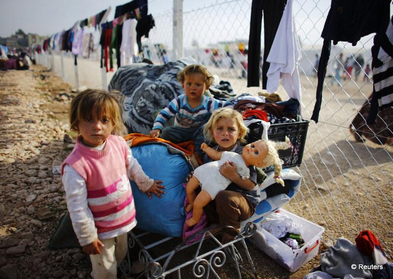 Kurdish refugee girls from Kobani play in a refugee camp in Suruc